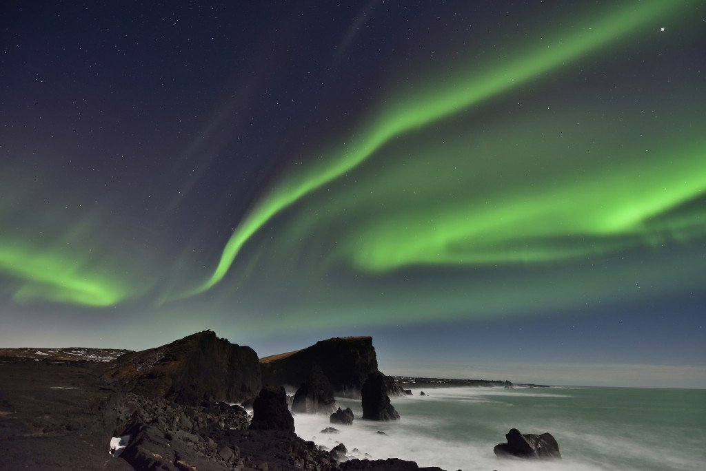 Northern Lights over Reykjanes Peninsula Sea Stacks, Iceland by: Diana Robinson (CC)