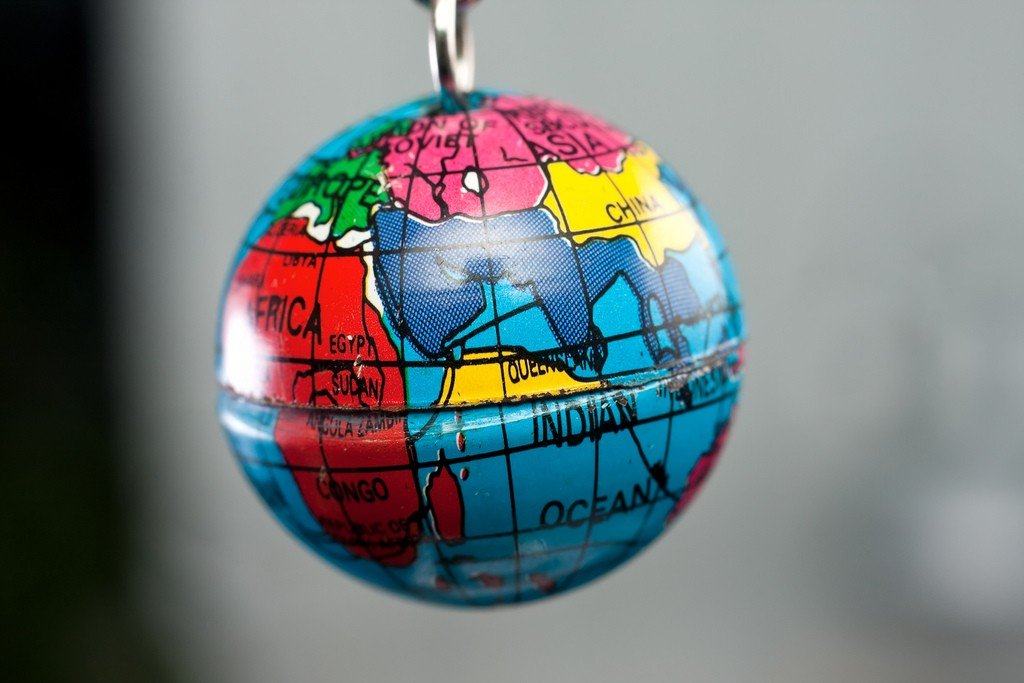 Macro of tiny Earth globe hanging on key chain by: Horia Varlan (CC)