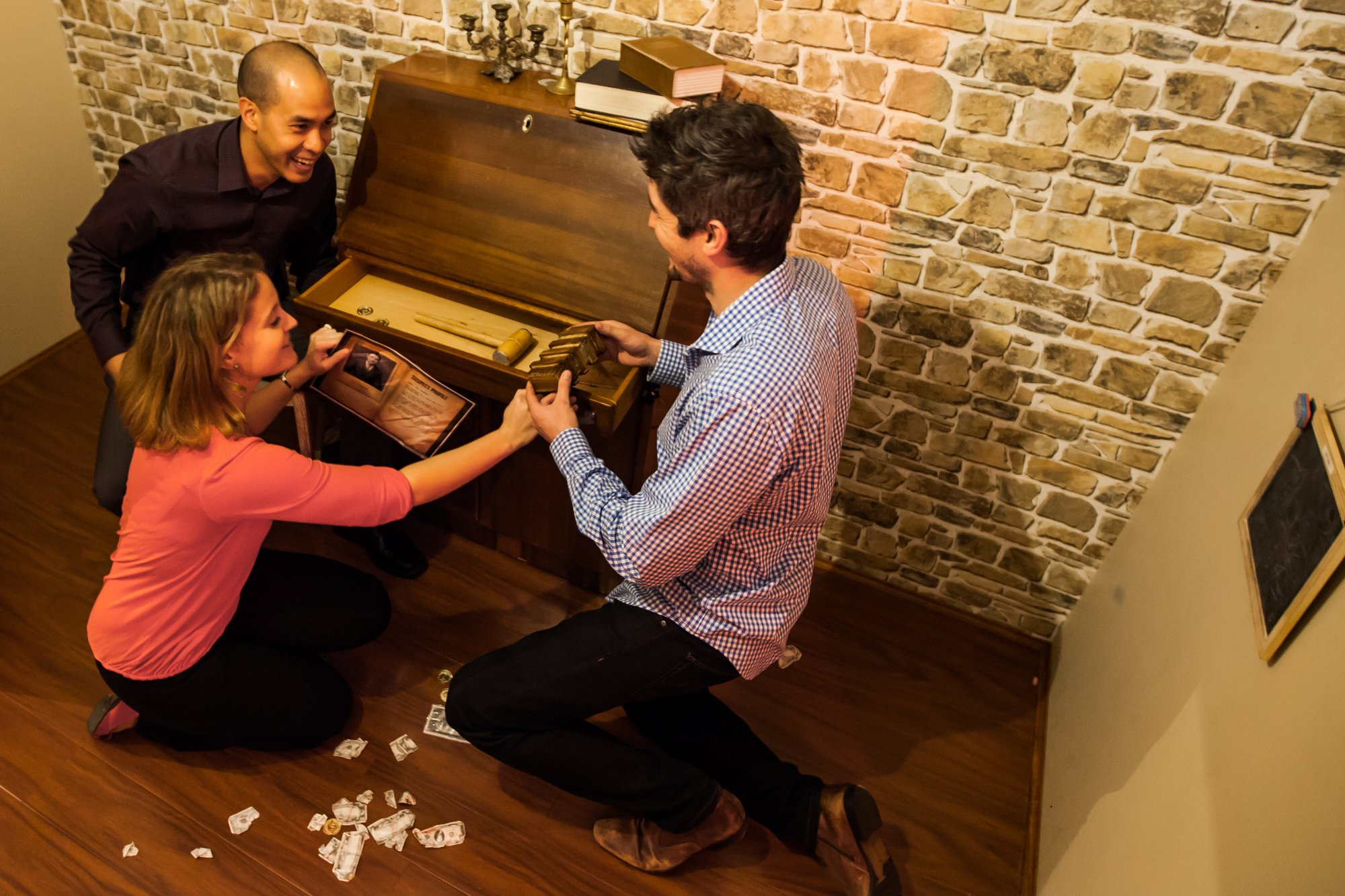 Real players playing one of Escape Hunt's real escape rooms