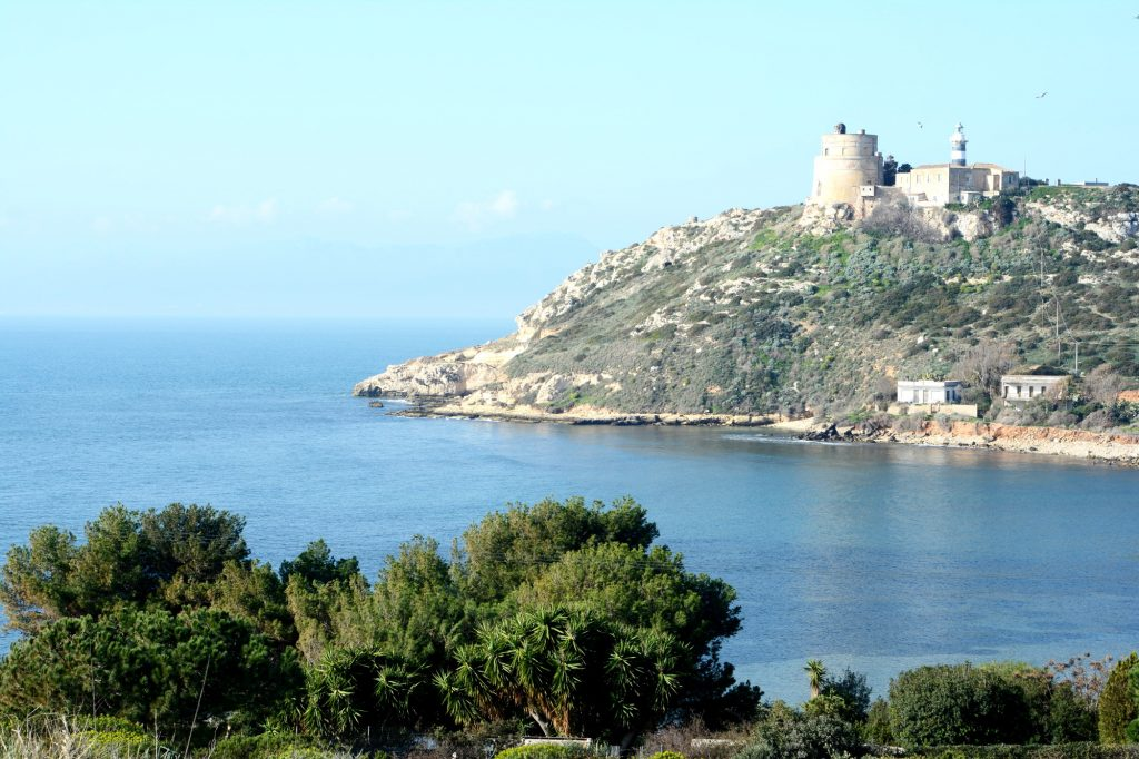 A view of the lighthouse in Cagliari from the Sella del Diavolo hilltop in Sardinia.