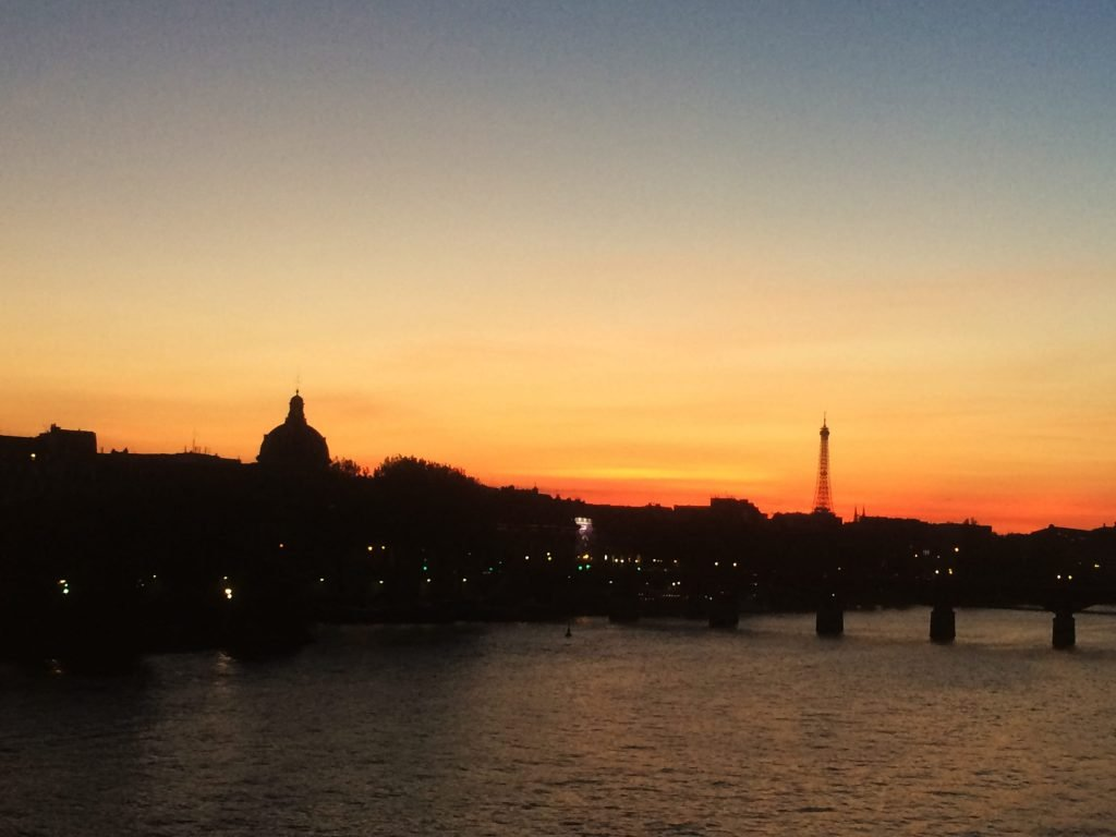 A beautiful sunset framing the Eiffel Tower and the Seine.